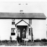 The home of Ed and Lizzie Mabry, a two story farm house they built by hand, circa 1922.