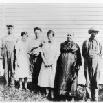 Ed and Lizzie seen with neighbors outside of their home, circa 1922.